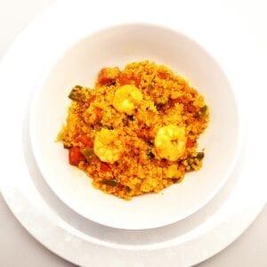 Chorizo, prawn and pepper quinoa paella in a bowl