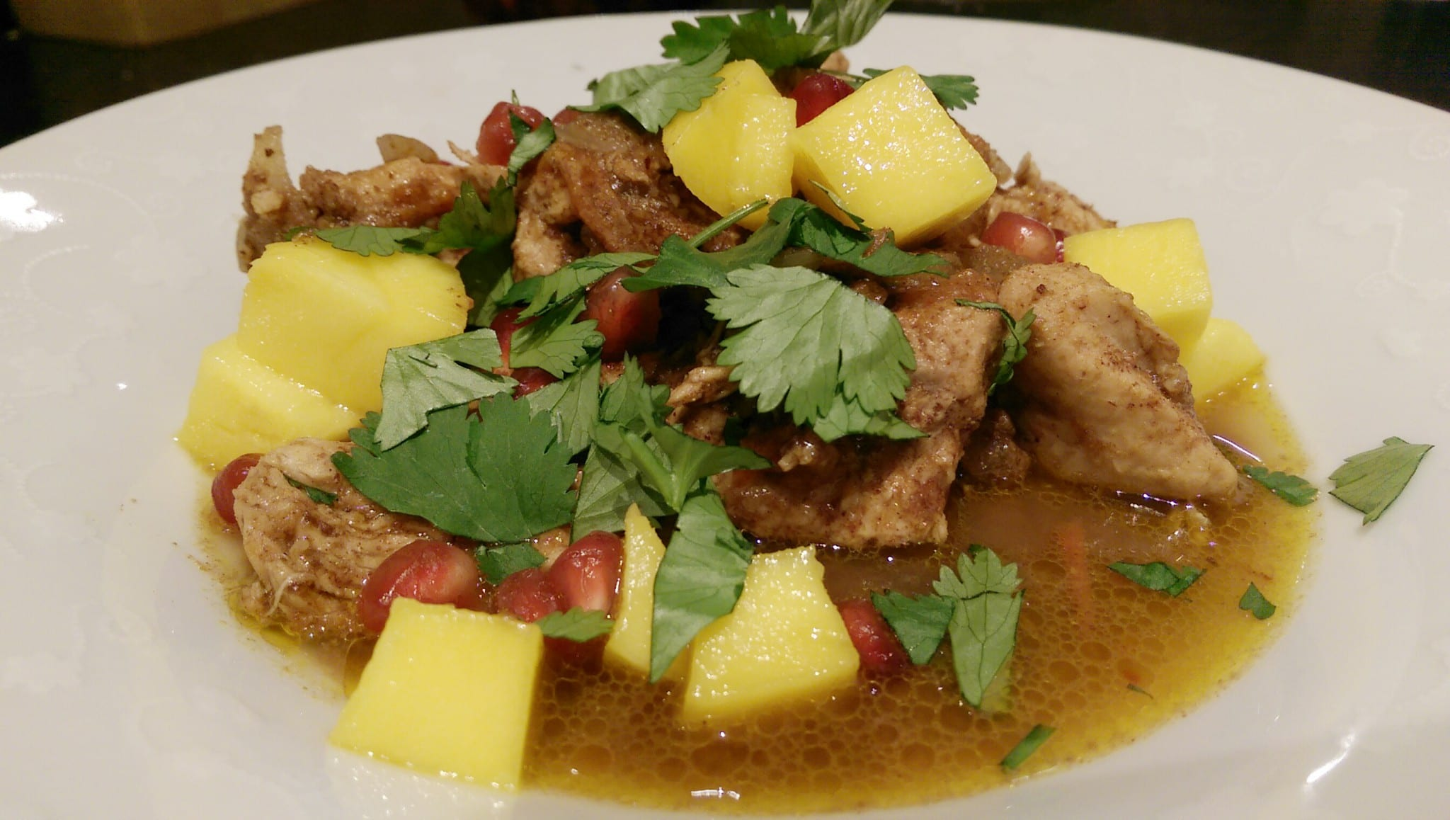 mango and pomegranate chicken dish