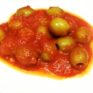 Whole green olives in tomato sauce