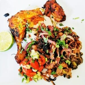 chicken with beans, fried onions and coriander