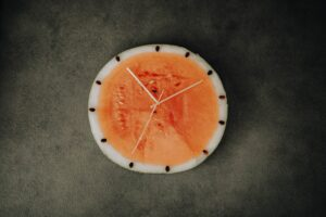 a slice of water melon made to look like a clock